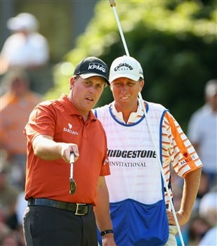 AKRON, OH - AUGUST 03:  Phil Mickelson of USA and caddie Jim ' Bones' Mackay line up his putt on the 16th hole during final round of the World Golf Championship Bridgestone Invitational on August 3, 2008 at Firestone Country Club in Akron, Ohio.  (Photo by Stuart Franklin/Getty Images)