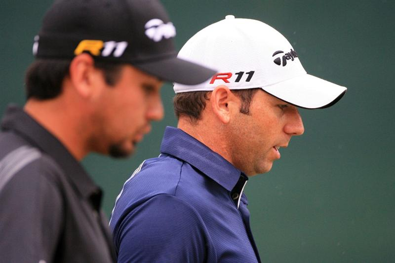 FORT WORTH, TX - MAY 20: Jason Day of Australia (L) and Sergio Garcia of Spain walk off the 17th tee during the second round of the Crowne Plaza Invitational at Colonial Country Club on May 20, 2011 in Fort Worth, Texas. (Photo by Hunter Martin/Getty Images)