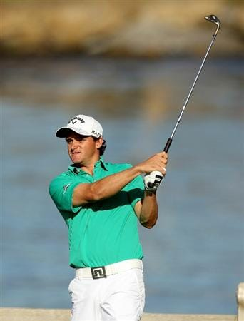 PEBBLE BEACH, CA - FEBRUARY 13:  Sam Saunders tees off on the 7th hole during the final round of the AT&T Pebble Beach National Pro-Am at the Pebble Beach Golf Links on February 13, 2011 in Pebble Beach, California.  (Photo by Ezra Shaw/Getty Images)
