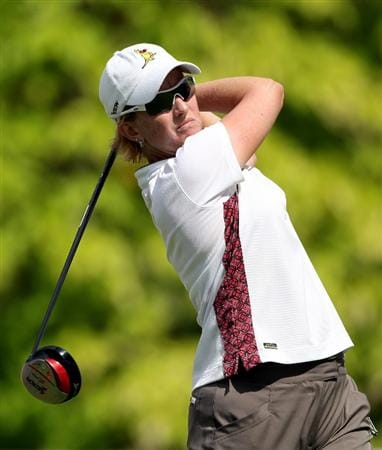 SINGAPORE - FEBRUARY 25:  Karrie Webb of Australia hits her tee shot on the sixth hole during the first round of the HSBC Women's Champions at the Tanah Merah Country Club on February 25, 2010 in Singapore.  (Photo by Andrew Redington/Getty Images)