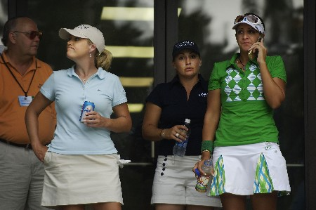 SOUTHERN PINES, NC - JUNE 29:  (L-R) Cristie Kerr, Kelli Kuehne and Nicole Hage wait at the clubhouse for play to resume during round two of the U.S. Women's Open Championship at Pine Needles Lodge & Golf Club June 29, 2007 in Southern Pines, North Carolina.  (Photo by Jonathan Ernst/Getty Images)