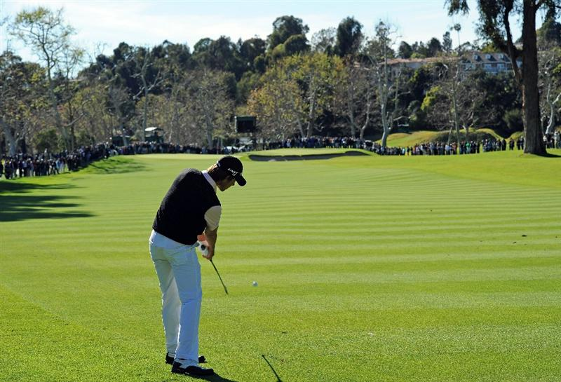 PACIFIC PALISADES, CA - FEBRUARY 20:  Aaron Baddeley of Australia plays his approach shot on the 15th hole during the final round of the Northern Trust Open at Riviera Country Club on February 20, 2011 in Pacific Palisades, California.  (Photo by Stuart Franklin/Getty Images)