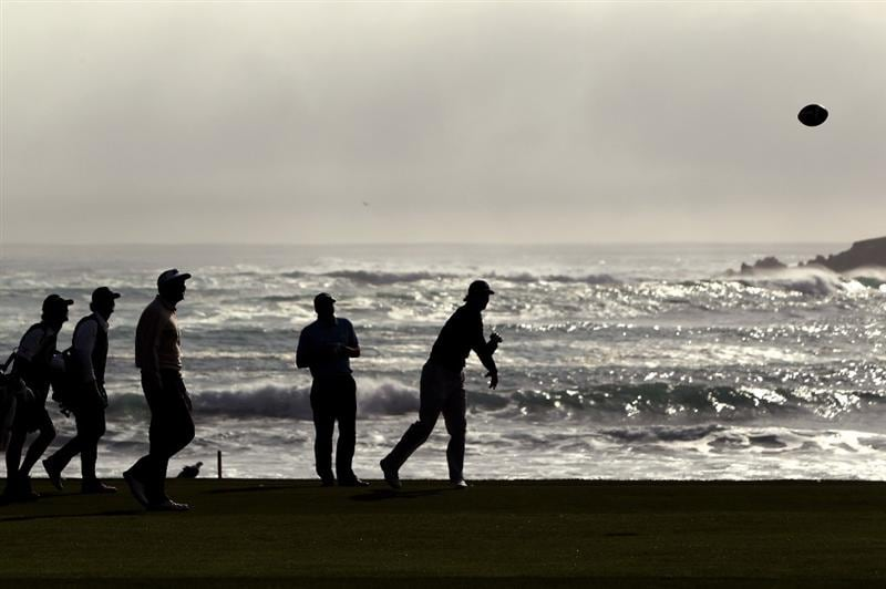 PEBBLE BEACH, CA - FEBRUARY 13:  National Football League player Tom Brady tosses the football on the 18th hole during round three of the AT&T Pebble Beach National Pro-Am at Pebble Beach Golf Links on February 13, 2010 in Pebble Beach, California.  (Photo by Ezra Shaw/Getty Images)