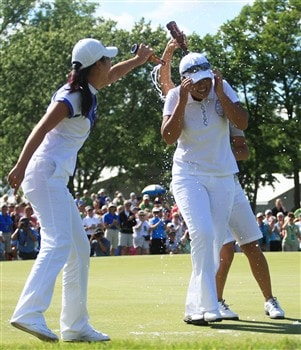 EDINA, MN - JUNE 29:  Ji Young Oh of Korea (L) poors beer on InBee Park of Korea on the 18th green after InBee won in the final round of the 2008 U.S. Women's Open at Interlachen Country Club on June 29, 2008 in Edina, Minnesota.  (Photo by Travis Lindquist/Getty Images)
