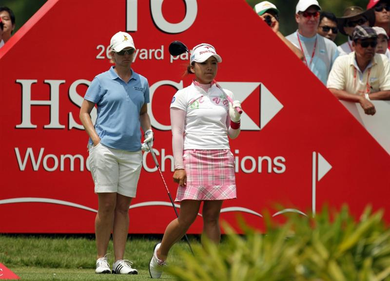 SINGAPORE - FEBRUARY 27:  Chie Arimura of Japan and Karrie Webb of Australia during the final round of the HSBC Women's Champions at Tanah Merah Country Club  on February 27, 2011 in Singapore, Singapore.  (Photo by Ross Kinnaird/Getty Images)