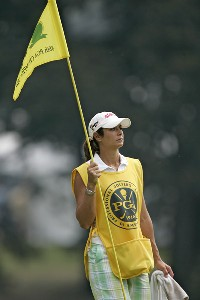 Ron Philo, Jr. caddie his sister Laura Diaz during the second round of the 88th PGA Championship at Medinah Country Club in Medinah, Illinois, on August 18, 2006.Photo by Hunter Martin/WireImage.com