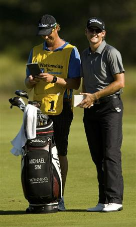 CHARLESTON, SC - OCTOBER 22:  Michael Sim smiles while checking yardage on the 14th hole during the first round of the Nationwide Tour Championship at Daniel Island on October 22, 2009 in Charleston, South Carolina. (Photo by Chris Keane/Getty Images)