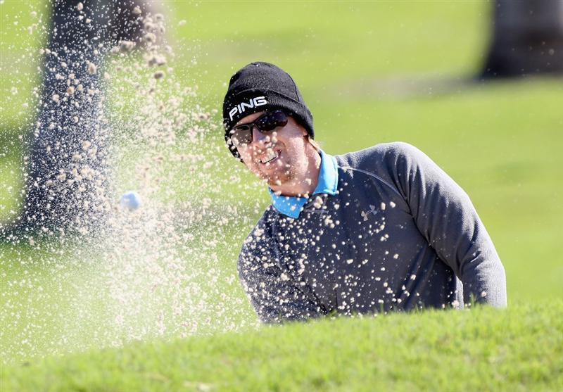 DORAL, FL - MARCH 11:  Hunter Mahan plays a bunker shot on the seventh hole during the completion of the first round of the 2011 WGC- Cadillac Championship at the TPC Blue Monster at the Doral Golf Resort and Spa on March 11, 2011 in Doral, Florida.  (Photo by Sam Greenwood/Getty Images)