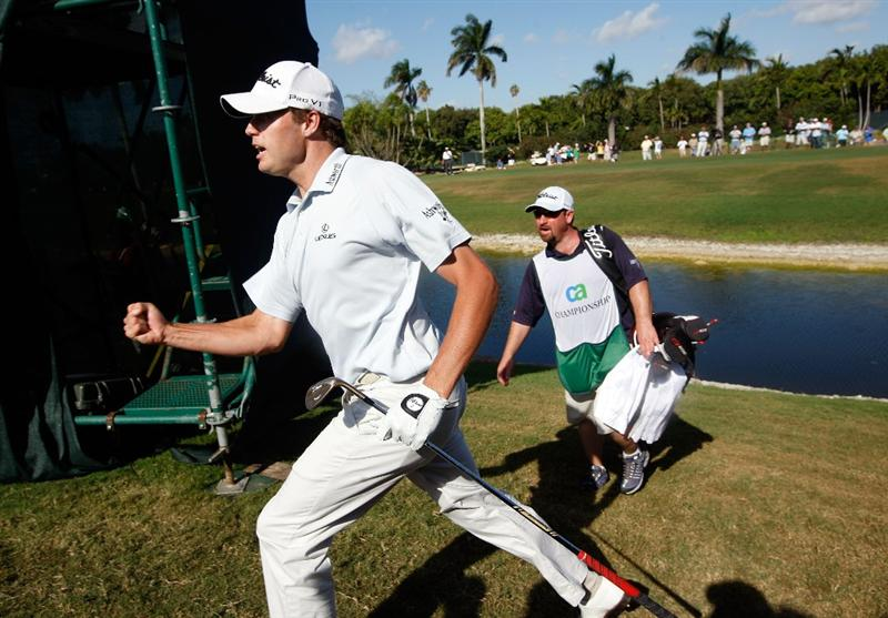 DORAL, FL - MARCH 15:  Nick Watney pumps his fist after chipping in on the 9th hole during the final round of the World Golf Championships-CA Championship on March 15, 2009 at the Doral Golf Resort and Spa in Doral, Florida.  (Photo by Jamie Squire/Getty Images)
