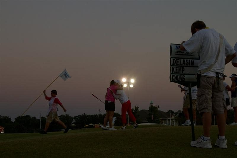 PRATTVILLE, AL - OCTOBER 8: With artificial lighting illuminating the ninth green, Sarah Kemp of Australia embraces Ilmi Chung of South Korea after completing their round as darkness fell during the second round of the Navistar LPGA Classic at the Senator Course at the Robert Trent Jones Golf Trail  on October 8, 2010 in Prattville, Alabama. (Photo by Darren Carroll/Getty Images)