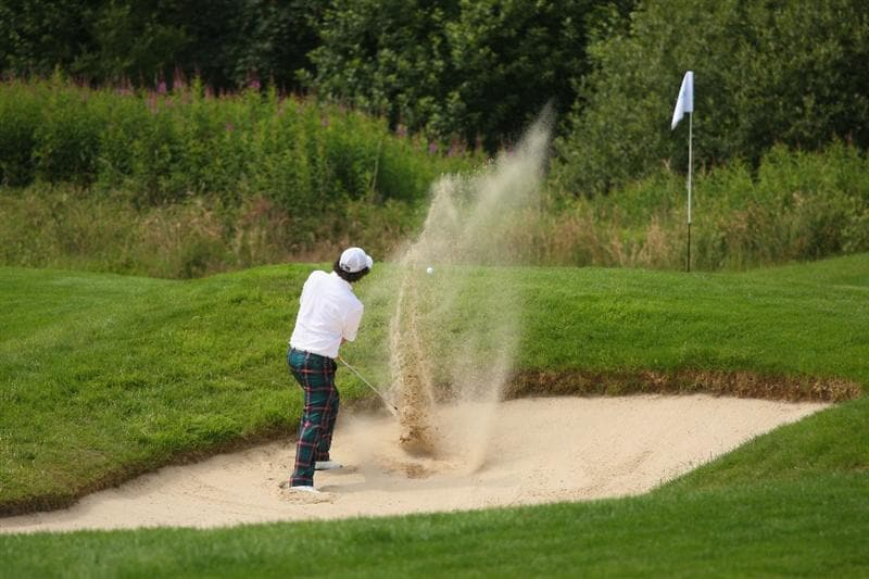LUSS, SCOTLAND - JULY 11:  Rory McIlroy of Northern Ireland hits out of a bunker on the 13th hole during the Third Round of The Barclays Scottish Open at Loch Lomond Golf Club on July 11, 2009 in Luss, Scotland.  (Photo by Andrew Redington/Getty Images)