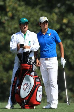 AUGUSTA, GA - APRIL 08:  Amateur Matteo Manassero of Italy (R) waits with his caddie Alberto Binaghi on the fifth hole during the first round of the 2010 Masters Tournament at Augusta National Golf Club on April 8, 2010 in Augusta, Georgia.  (Photo by David Cannon/Getty Images)
