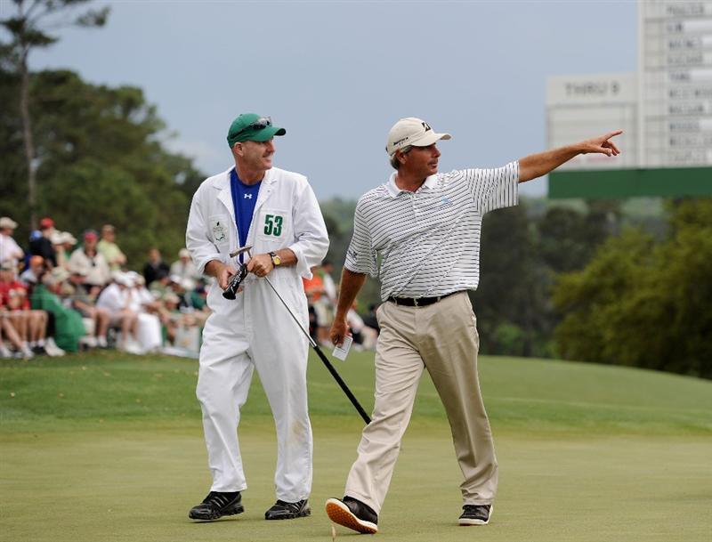 AUGUSTA, GA - APRIL 08:  Fred Couples walks off the 18th green alongside his caddie Joe Lacava after a six-under par 66 during the first round of the 2010 Masters Tournament at Augusta National Golf Club on April 8, 2010 in Augusta, Georgia.  (Photo by Harry How/Getty Images)