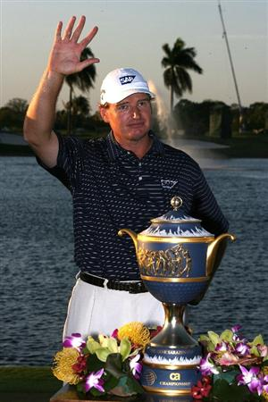 DORAL, FL - MARCH 14:  Ernie Els of South Africa waves to the gallery next to the Gene Sarazen Cup trophy on the 18th hole after winning the 2010 WGC-CA Championship at the TPC Blue Monster at Doral on March 14, 2010 in Doral, Florida.  (Photo by Doug Benc/Getty Images)