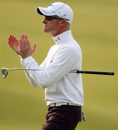 ST ANDREWS, SCOTLAND - OCTOBER 05:  Simon Dyson of England celebrates on the 18th green after victory at the The Alfred Dunhill Links Championship at The Old Course on October 5, 2009 in St.Andrews, Scotland.  (Photo by Andrew Redington/Getty Images)