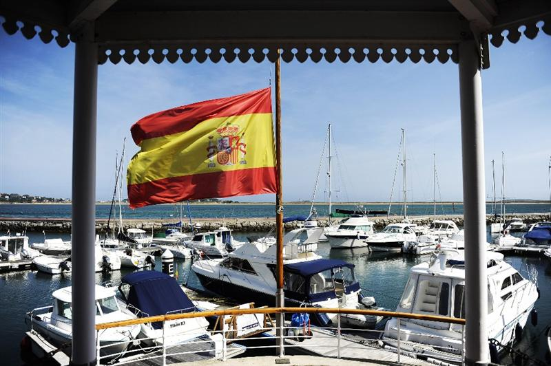 PEDRENA, SPAIN - MAY 10:  A Spanish flag flies at half mast in the marina in preparation for the funeral service of legendary Spanish golfer Seve Bellesteros on May 10, 2011 in Pedrena, Spain.  (Photo by David Ramos/Getty Images)