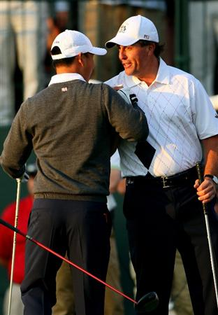 LOUISVILLE, KY - SEPTEMBER 19:  Phil Mickelson of the USA team shakes hands with his playing partner Anthony Kim on the first tee during the morning foursomes on day one of the 2008 Ryder Cup at Valhalla Golf Club on September 19, 2008 in Louisville, Kentucky.  (Photo by Andrew Redington/Getty Images)