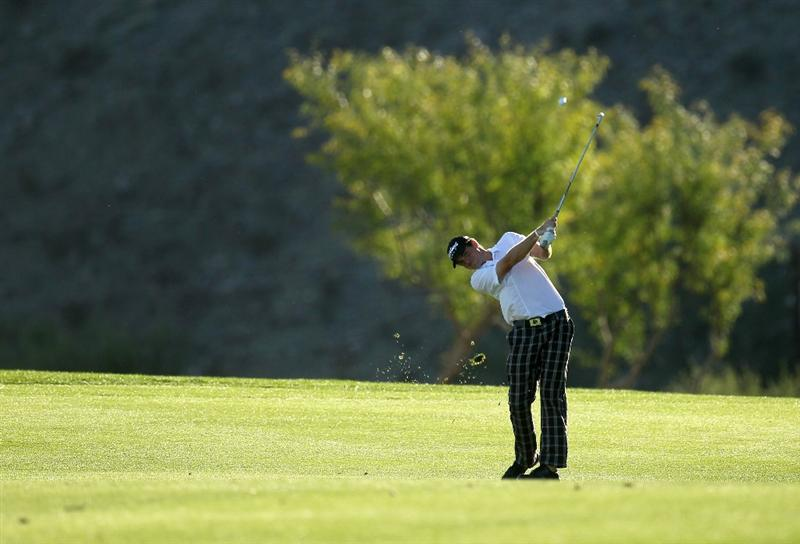 LA QUINTA, CA - JANUARY 22:  Keegan Bradley hits his second shot on the 15th hole during round four of the Bob Hope Classic at Silver Rock Resort on January 22, 2011 in La Quinta, California.  (Photo by Stephen Dunn/Getty Images)