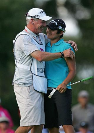 MELBOURNE, AUSTRALIA - MARCH 14:  Yani Tseng of Chinese Tapai is hugged by her caddie David Poitevent after completing the 18th hole during the final round of the 2010 Women's Australian Open at The Commonwealth Golf Club on March 14, 2010 in Melbourne, Australia.  (Photo by Scott Barbour/Getty Images)