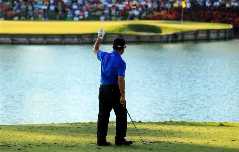 PONTE VEDRA BEACH, FL - MAY 15:  K.J. Choi of South Korea waves after hitting his tee shot on the 17th tee during the final round of THE PLAYERS Championship held at THE PLAYERS Stadium course at TPC Sawgrass on May 15, 2011 in Ponte Vedra Beach, Florida.  (Photo by Streeter Lecka/Getty Images)