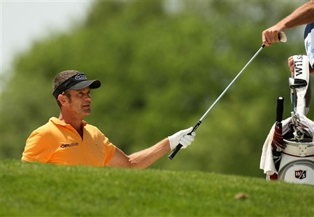 IRVING, TX - APRIL 25:  Jesper Parnevik of Sweden is handed an ironbefore hitting from a fairway bunker on the fourth hole during the second round of the EDS Byron Nelson Championship at TPC Four Seasons Resort Las Colinas on April 25, 2008 in Irving, Texas.  (Photo by Stephen Dunn/Getty Images)