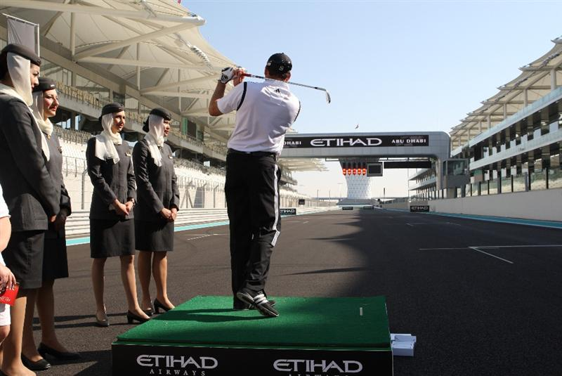 ABU DHABI - UNITED ARAB EMIRATES - JANUARY 20:   Sergio Garcia tees off at the finish straight of the Abu Dhabi Grand Prix Track during the Etihad Whack on the Track at the Abu Dhabi Grand Prix Track on January 20, 2010 in Abu Dhabi, United Arab Emirates.  (Photo by Jack Jacob/Getty Images for Eithad)