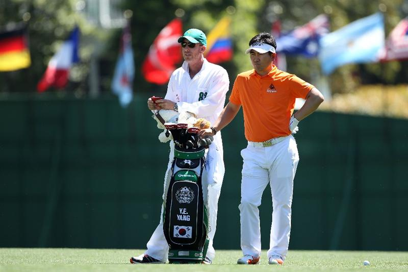 AUGUSTA, GA - APRIL 07:  Y.E. Yang of South Korea waits in the first fairway with his caddie Michael Bestor during the first round of the 2011 Masters Tournament at Augusta National Golf Club on April 7, 2011 in Augusta, Georgia.  (Photo by Andrew Redington/Getty Images)