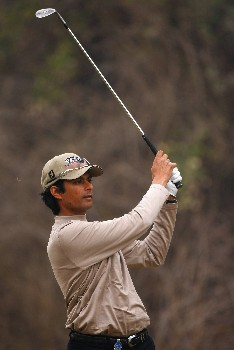 NEW DELHI, INDIA - FEBRUARY 07:  Digvijay Singh of India plays his approach shot on the 18th hole during the first round of the Emaar-MGF Indian Masters at the Delhi Golf Club on February 7, 2008 in Delhi, India.  (Photo by Stuart Franklin/Getty Images)