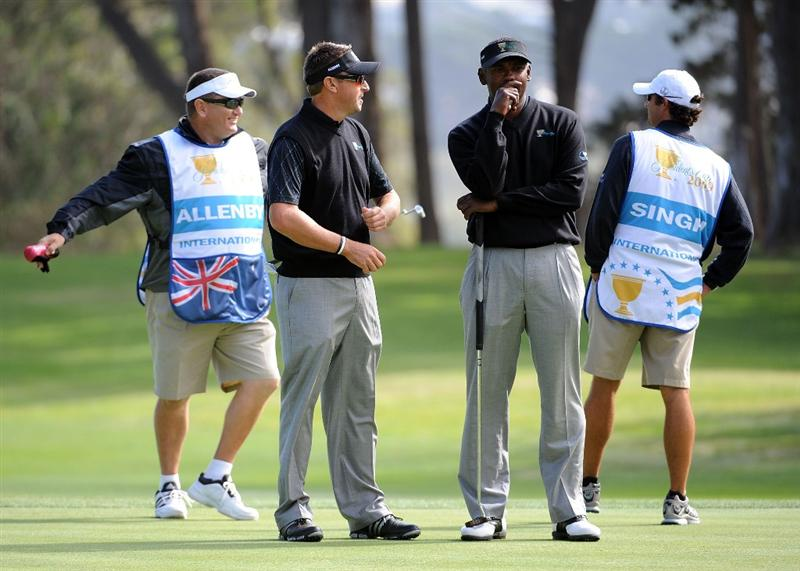 SAN FRANCISCO - OCTOBER 08:  Vijay Singh and Robert Allenby of the International Team on the green during the Day One Foursome Matches of The Presidents Cup at Harding Park Golf Course on October 8, 2009 in San Francisco, California.  (Photo by Harry How/Getty Images)