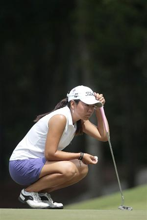 MOBILE, AL - MAY 14:  Mina Harigae lines up her putt on the eighth green during second round play in the Bell Micro LPGA Classic at the Magnolia Grove Golf Course on May 14, 2010 in Mobile, Alabama.  (Photo by Dave Martin/Getty Images)