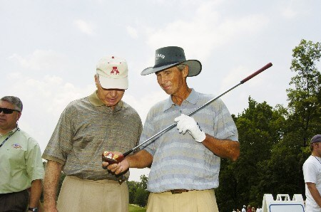 Bart Starr and Hubert Green check  a persimmon driver during a ceremony celebrating the PGA TOUR's 'Drive to a Billiion'   during   the Thursday  Pro Am at the 2005 Bruno's Memorial Classic, May 19, in Birmingham.Photo by Al Messerschmidt/WireImage.com