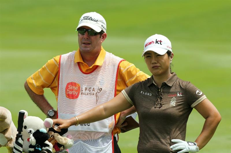 KUALA LUMPUR, MALAYSIA - OCTOBER 24 : Meena Lee of Korea Republic waits for her turn to play with her caddie on the 14th hole during the Final Round of the Sime Darby LPGA on October 24, 2010 at the Kuala Lumpur Golf and Country Club in Kuala Lumpur, Malaysia. (Photo by Stanley Chou/Getty Images)
