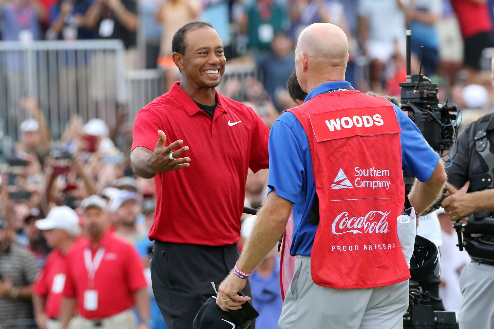 New-look Tiger Woods wins No. 80