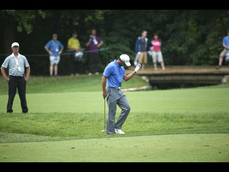 Bad: Woods' elbow flairs up