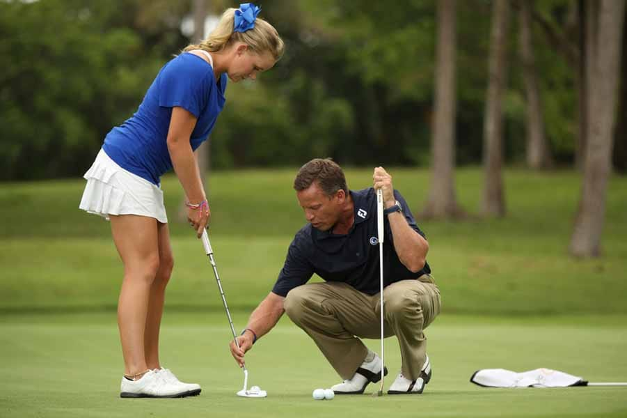 Breed Helps Shannon Fish Line Up Her Putt