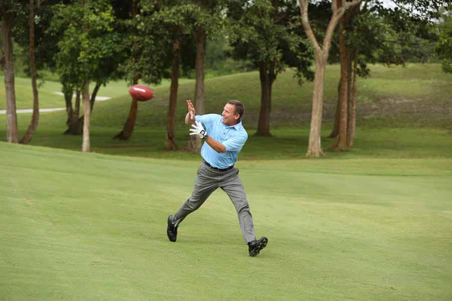 Michael Breed Catches a Pass From Mark Rypien.