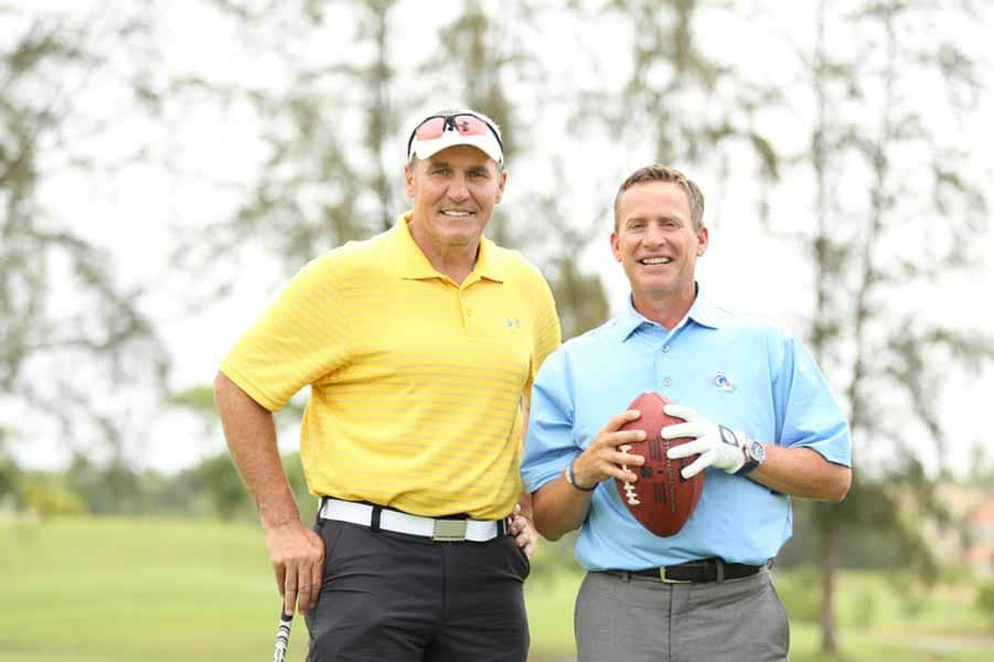 Mark Rypien and Michael Breed Posing for a Picture.