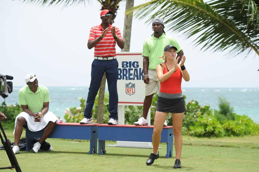Jerry Rice and Emily Talley Cheer on Isaac Sanchez
