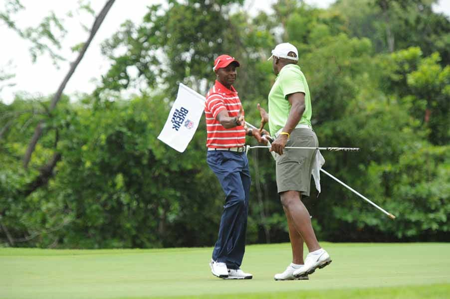 Jerry Rice and Tim Brown Shake Hands on the Set of Big Break NFL Puerto Rico.