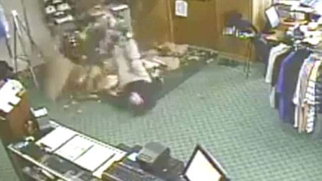 Guy falling through the roof of a pro shop