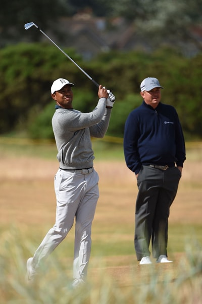 Tiger Woods and Jason Dufner