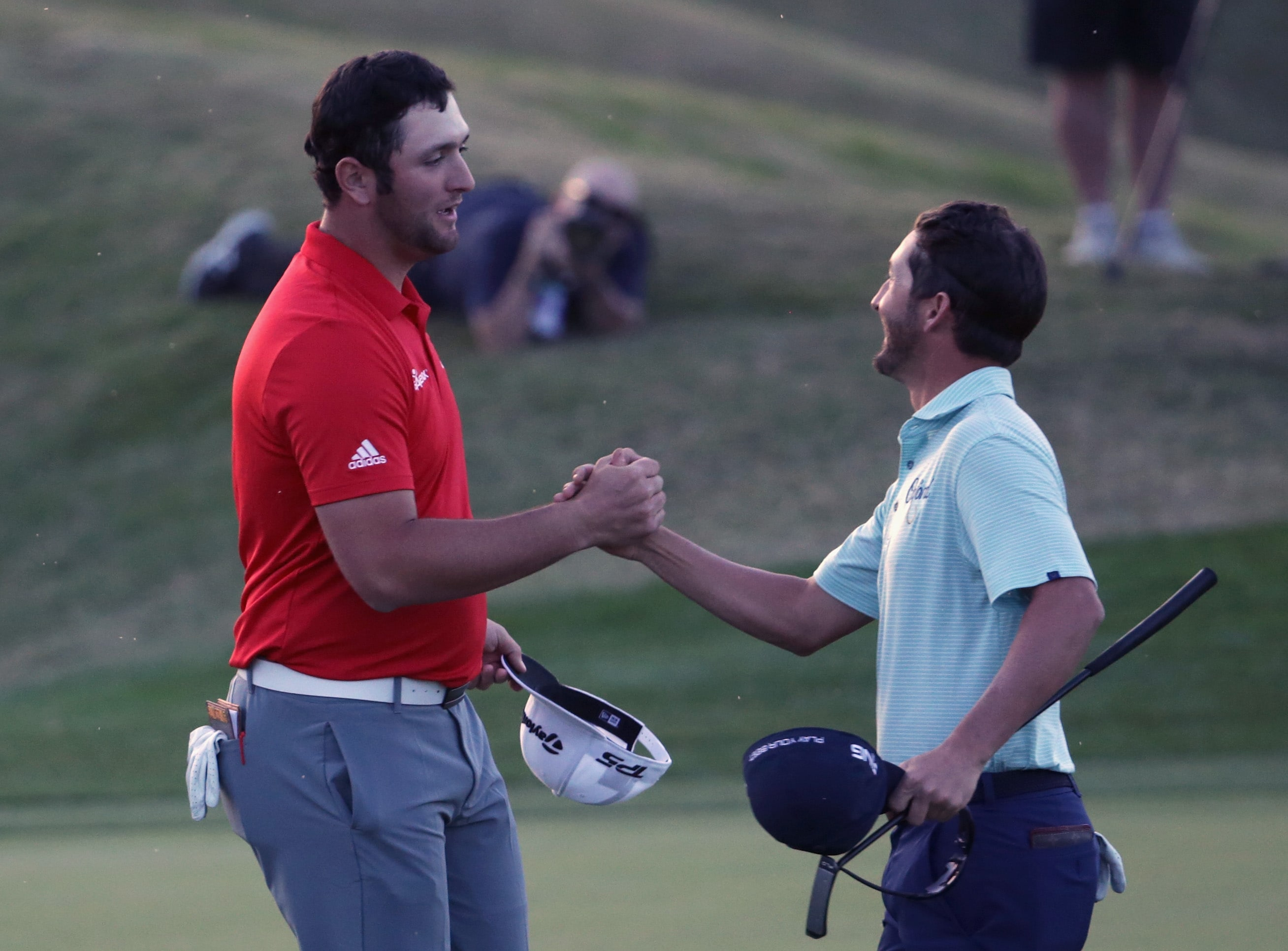Jon Rahm and Andrew Landry