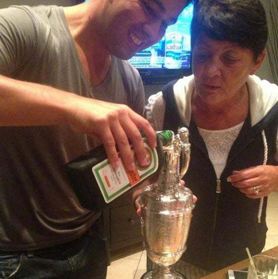 Rory McIlroy filling the claret jug with Jägermeister